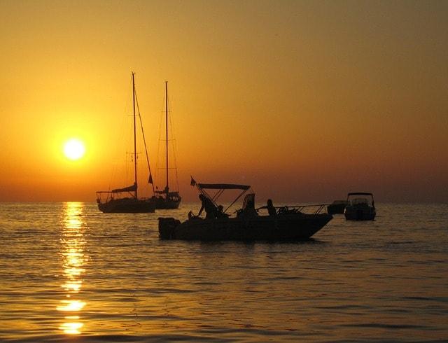 Enjoy sunset on a crewed yacht charter