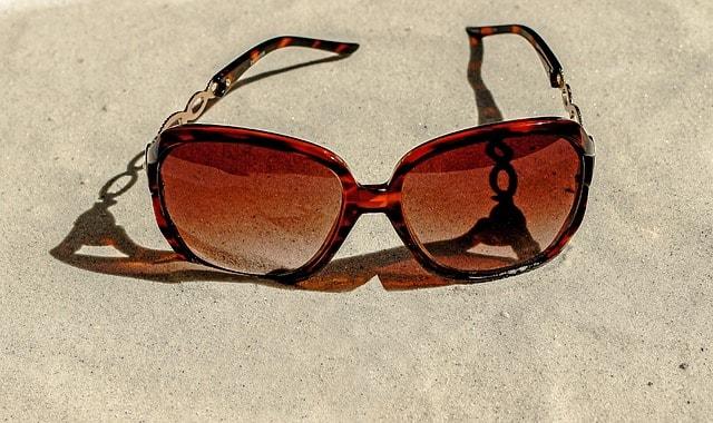 Sun glass on the sand