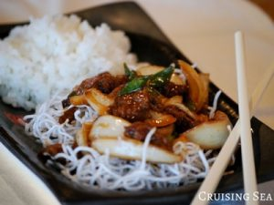 Mongolian Beef with spring onions on a plate
