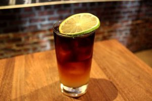 Dark and stormy drink in a glass
