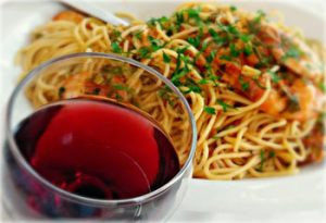 Spaghetti with wine on a table